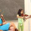 Playing violin in the classroom. Photo by Richard Casamento.
