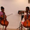 Taiwo collaborates with a student to perform a cello duet! Photo by Richard Casamento.