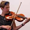 Sara Caswell playing her hardanger fiddle
